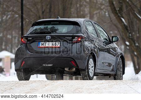 Riga, Latvia - February 9, 2021: Metallic Graytoyota Yaris Hybrid Y20 Edition Hatchback Car Parked N