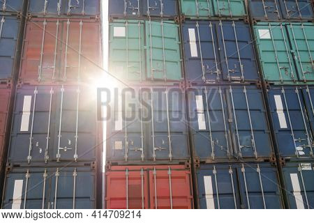 Pile Stack Of Many Colorful Container With Sun Flair  At The Freight Forwarder Site Waiting To Load