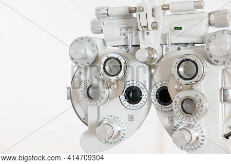 Selective Focus At Optometry Frame Equipment. With Blurred White Background For Copy Space. Optometr