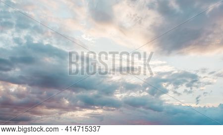 Blue Sky With A Pastel Colored. Soft Texture Of Fluffy Clouds. Concept For Airy Light Dreams And Tra