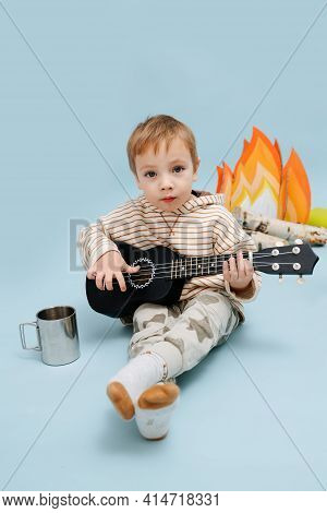 Enthusiastic Little Barefoot Blond Boy Climbing On A Stepping Stool. He\\\'s Wearing Striped Long-sl