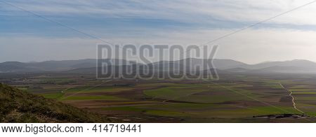 Panorama Landscape Of Brown And Green Farm Fields