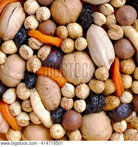 Natural Background Of Nuts, Dried Fruits: Prunes, Plums, Apricots