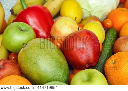 A Pile Of Organic Fruit And Vegetables. Close Up.