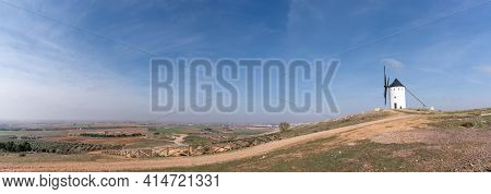 Panorama Landscape With Awhitewashed Historic Windmill Typical Of The La Mancha Region Of Central Sp