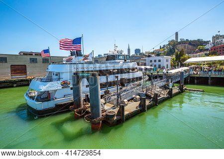 San Francisco, California, United States - August 14, 2016: San Francisco Pier 33 With Alcatraz Crui