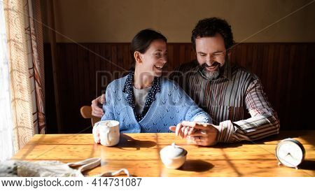 Portrait Of Happy Poor Mature Couple Resting Indoors At Home, Poverty Concept.