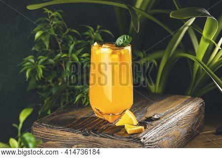 Citrus Cocktail, Orange Juice, Summer Orange Lemonade In Highball Glass Surrounded Decor In Dark Fre