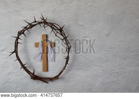 Crucifixion Of Jesus Christ. Cross And Crown Of Thorns On Grey Background.