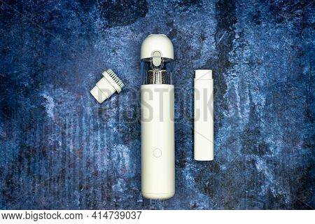 Portable Vacuum Cleaner White With Two Nozzles On A Blue Background