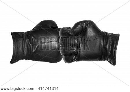 Two Leather-gloved Hands Greet Each Other With A Fist.greeting Each Other With A Gloved Fist During