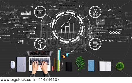 Business Growth Analysis With Person Using A Laptop Computer