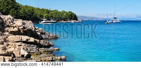 Luxury Yachts By Wild Adriatic Coastline Of Hvar Island. Blue Sky And Turquoise Sea Water. Maslinica