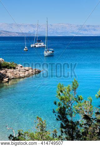 Luxury Yachts By Wild Adriatic Coastline Of Hvar Island. Blue Sky And Turquoise Sea Water. Maslinica