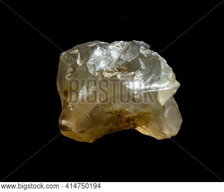 Raw Agate Quartz Minerals Nugget From Novy Urengoy, Russia. A Backlight Photo Of Stone Isolated On B