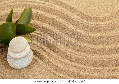 Balance Zen Stones In Sand And Green Leaves