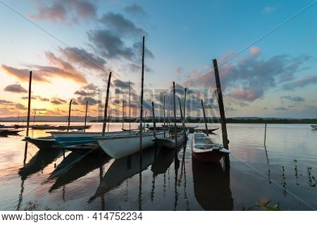 Boats Moored In The River In Late Afternoon In Santiago Do Iguape In Bahia.