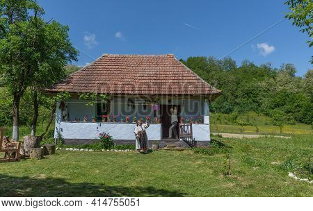 Salaj, Transylvania, Romania-may 14, 2018: Old Woman Dressed In Traditional Romanian Folk Costume Si