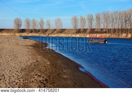 Off-season Riverside Sandy Beach . River Coast In The Springtime
