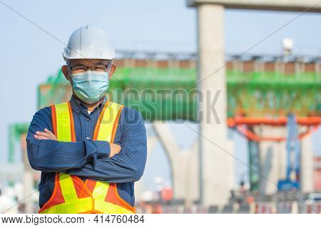 Portrait  Senior Asian Man Wear Face Mask Standing On Site Construction Background , Old Man Wear Ma