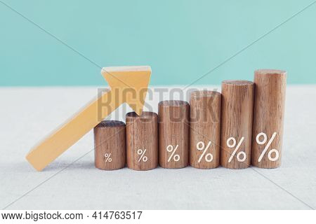 Wooden Blocks With Percentage Sign And Arrow Up, Financial Growth, Interest Rate And Mortgate Rate I