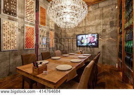 Novosibirsk, Russia - November  04 2018: A Restaurant Hall With A Dining Table For A Large Company.