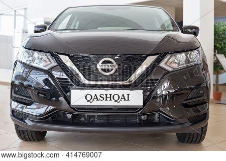 Russia, Izhevsk - February 19, 2021: Nissan Showroom. New Modern Qashqai Car In Dealer Showroom. Fro
