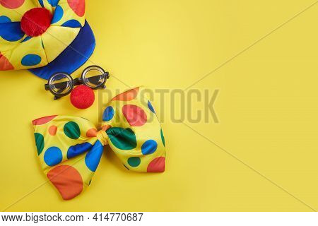 April Fools Day Background. Clown Glasses And Nose On Yellow Background