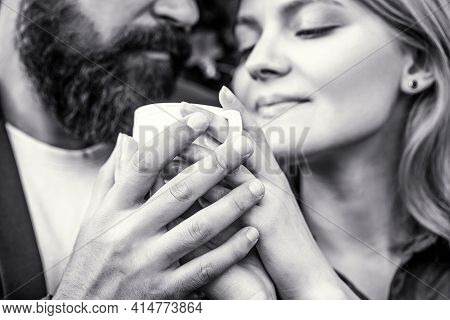 Couple Enjoying Coffe. Female And Man Hands Holding Cup Of Coffee. Couple In Love Holding Hands With