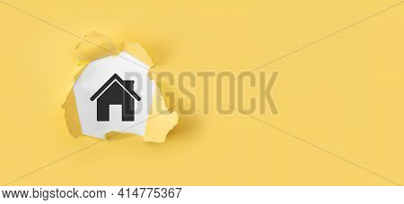 Real Estate Concept, Businessman Holding A House Icon.house On Hand. Torn Yellow Paper With House On