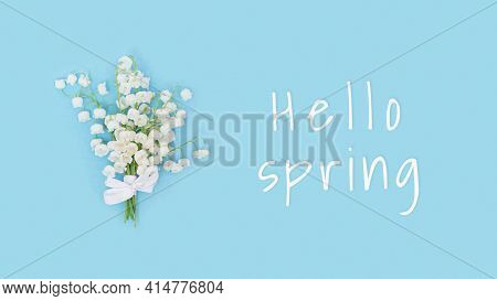 Delicate Spring Flowers Blooming White Lily Of The Valley On Blue. Spring Floral Conceptual Image.