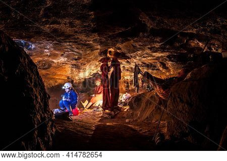 Speleologists Resting In Underground Camp. Exploring Caves Are Dangerous And Caving Is Considered An