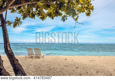 Cuba, Baracoa, Beach With Blue Water And Deck Chair