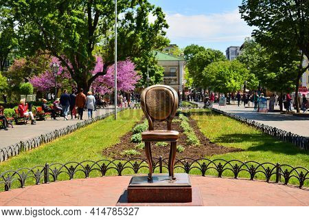 The Monument To The Twelfth Chair. Bronze Chair, Monument, Landmark Of Odessa. Blooming Spring Park.