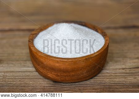 Monosodium Glutamate On Wooden Bowl On The Table Background, Msg For Food Seasoning