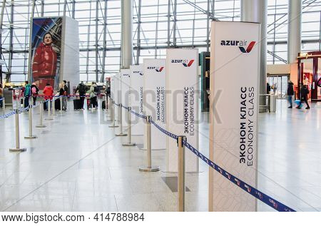 Moscow, Russia 03.14.2021 - Advertising Stands Of Azur Air Airline At Economy Class Check-in Counter