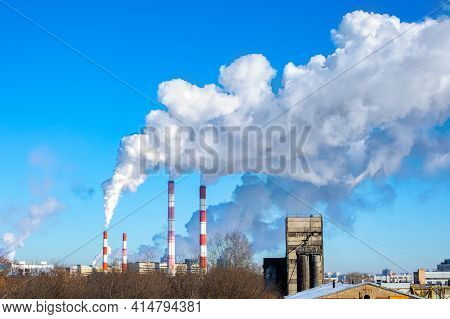 Flue Pipes Of A Bakery And Flour Factory, Industrial Area Of The City. Air Emissions And Food Produc
