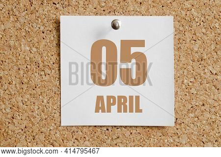 April 05. 05th Day Of The Month, Calendar Date.  White Calendar Sheet Attached To Brown Cork Board.