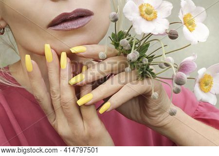 Fashionable Makeup And Yellow Manicure On Long-shaped Nails.