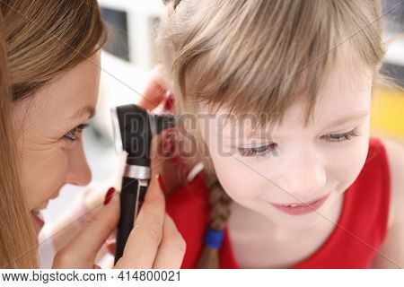 Doctor Conducts Medical Examination Of Ear Of Little Girl