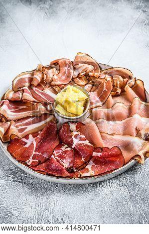 Meat Antipasto Platter, Pancetta, Salami, Sliced Ham, Sausage, Prosciutto, Bacon. Gray Background. T