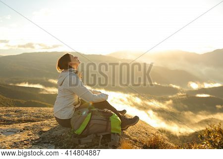 Happy Trekker Breathing Fresh Air In The Top Of A Mountain At Sunrise