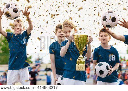 Soccer Team Celebration. Cheerful Children Celebrating Success In Football Tournament Game. Junior S