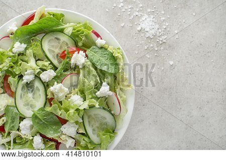 Lettuce Salad With Mixed Vegetable And Fresh Cheese Curd Close Up