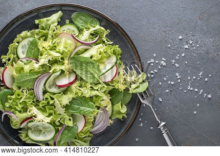 Healthy Green Salad With Fresh Vegetables On Grey Table Background