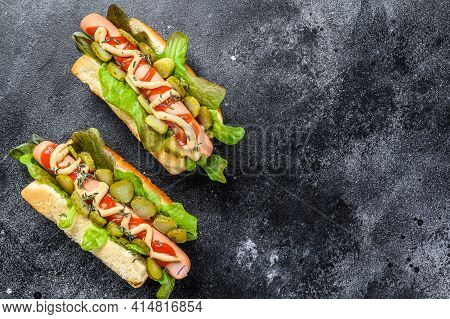 Homemade Hot Dogs With Vegetables, Lettuce And Condiments. Black Background. Top View. Copy Space