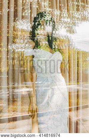 Mannequin In Window Display. Showcase Mannequin Wedding Dress