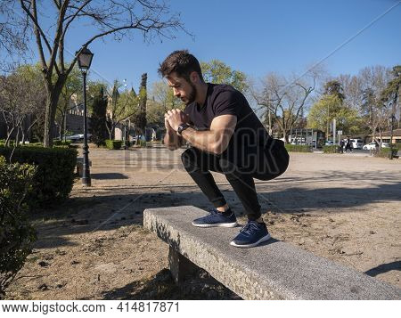 Young Caucasian Man Doing Warm-up Exercises Before Starting Calisthenics Training On A Sunny Spring
