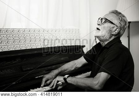 Home Pianist, Happy Elder Playing Music Piano With Song Impression Mood Gesture.