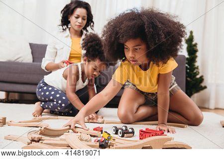 Single Mom With Two Daughter Playing Toy In Apartment. Nanny Looking Or Childcare At Home Black Peop